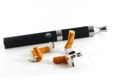 cigarette butts and electric cigarette isolated on white background vaping instead of smoking